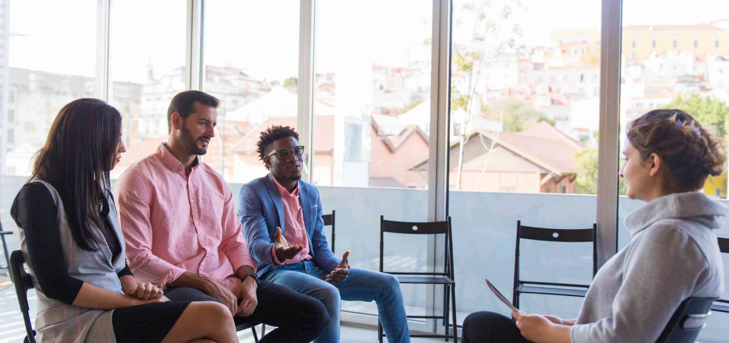 diverse-startup-team-consulting-coach.jpg