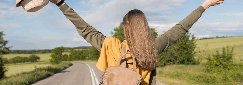 back-view-stylish-woman-enjoying-vacation.jpg
