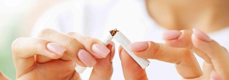 stop-smoking-close-up-woman-holding-broken-cigarette####.jpg